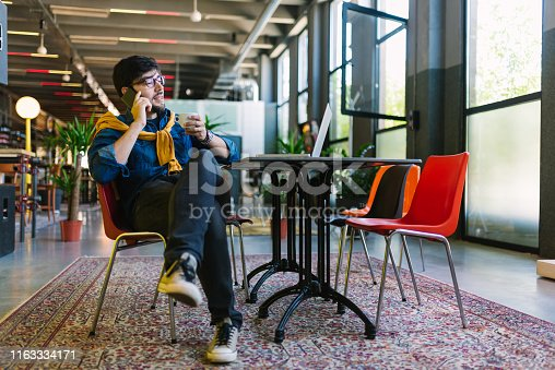 1040964880 istock photo Young freelancer in his cool office 1163334171