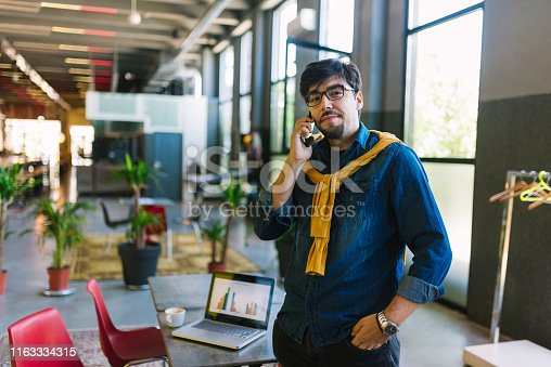 1040964880 istock photo Young freelancer in his cool office 1163334315