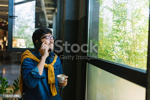 1040964880 istock photo Young freelancer in his cool office 1163334361