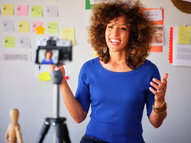 young freelancer video blogging - videocamera foto e immagini stock