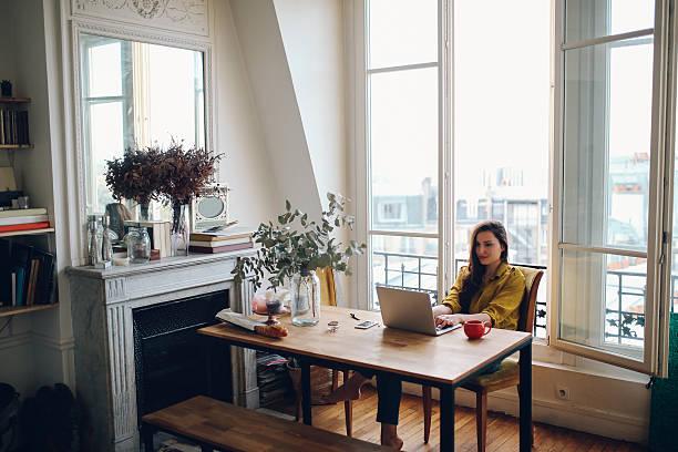 young freelancer woman relaxing in her parisian apartment - montmatre utsikt bildbanksfoton och bilder