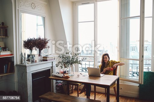 istock Young freelancer woman relaxing in her Parisian apartment 537706754