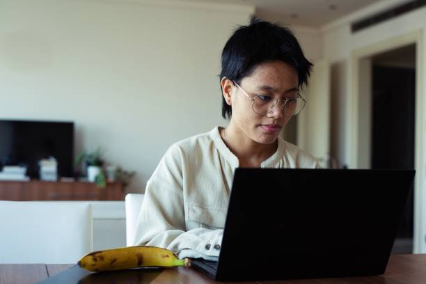 young freelancer working from home - showus стоковые фото и изображения