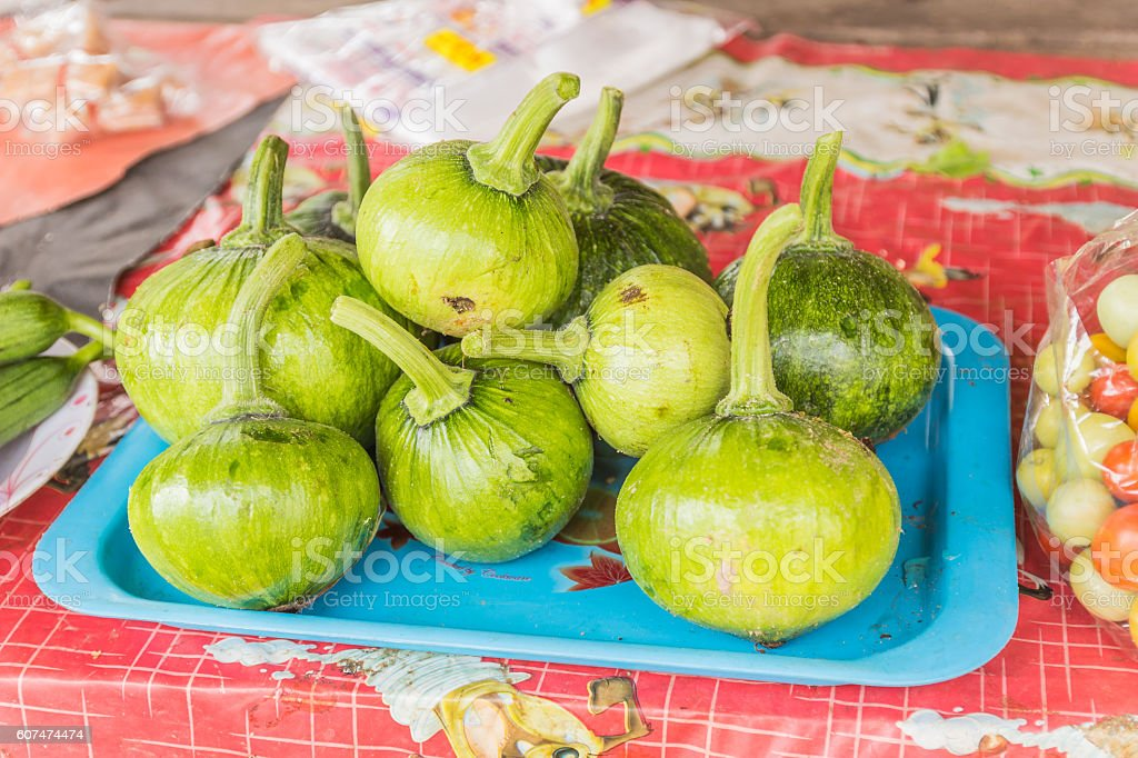 Young fresh pumpkin for sale at local Thai market stock photo