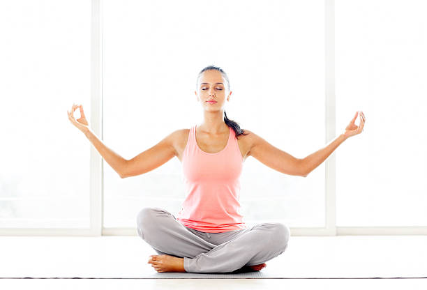 Young fresh woman in a yogatic pose stock photo