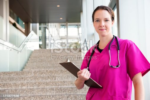 629994764istockphoto Young Friendly Nurse in Pink Scrubs 171327536