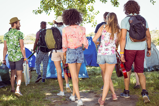 Young friends arriving at their campsite