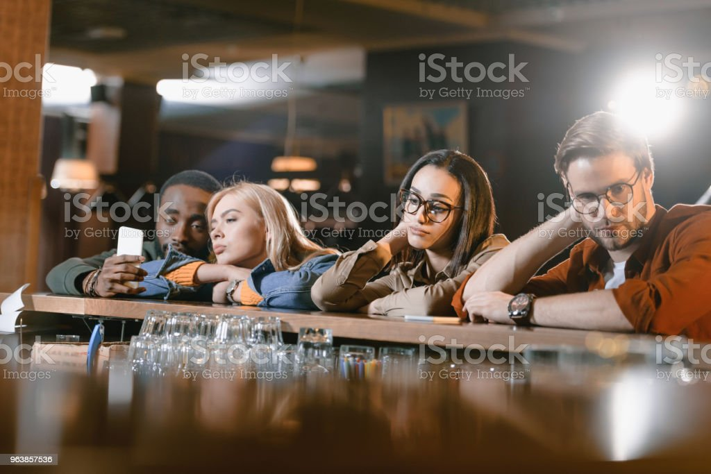 young friends at bar waiting a barman - Royalty-free Adult Stock Photo