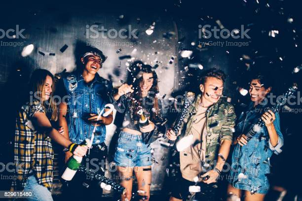 Young friends celebrating with champagnes and confetti at party picture id829618480?b=1&k=6&m=829618480&s=612x612&h=radp1iinqqmsx4sdf8szdlsz4rdvumyt8dxffcuck8k=