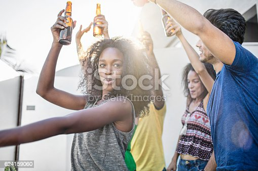 istock Young friends dancing at rooftop party 624159060