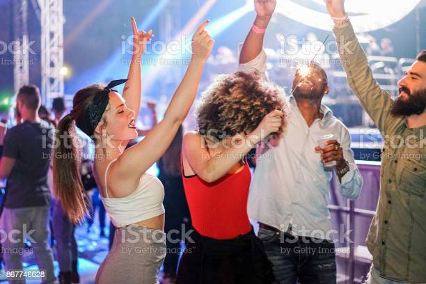 Young friends dancing in night club festival event party with dj in picture id867746628?b=1&k=6&m=867746628&s=612x612&h=untk fgdowlh5knqhyc9a d8ggh1x ubol tleeyh2i=