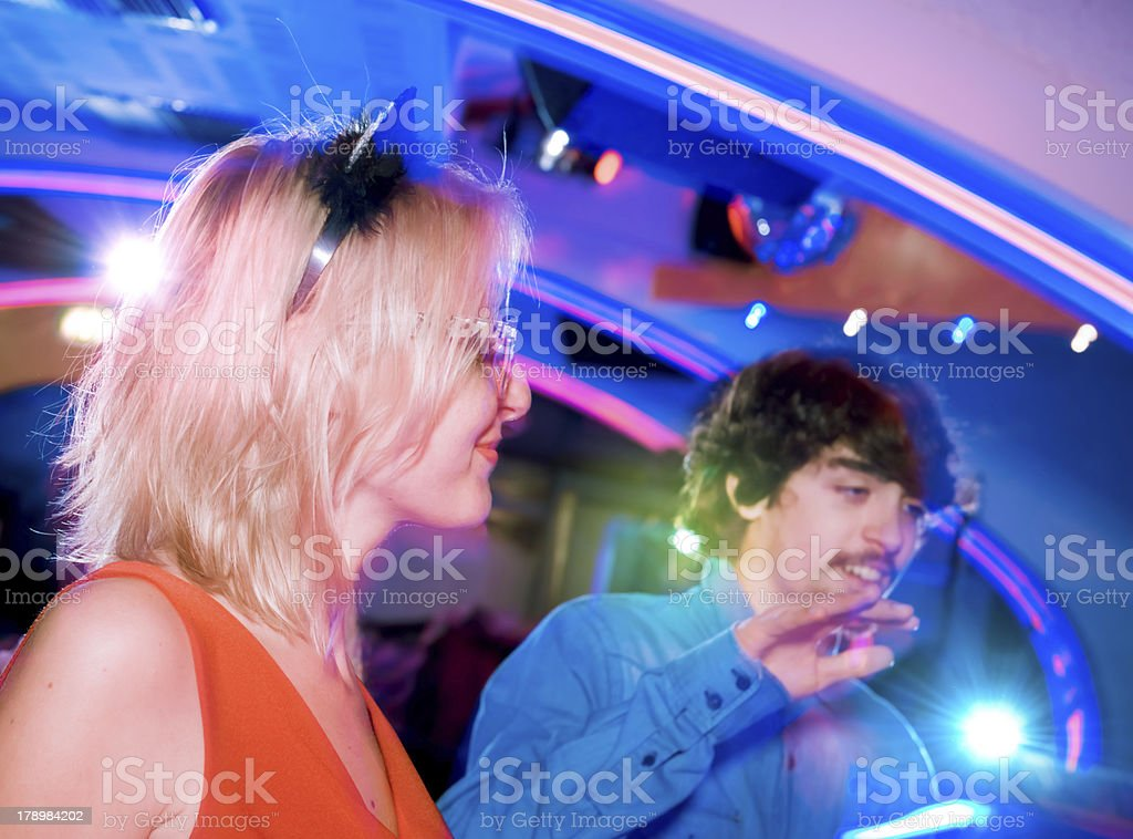 Young friends dancing in the nightclub royalty-free stock photo