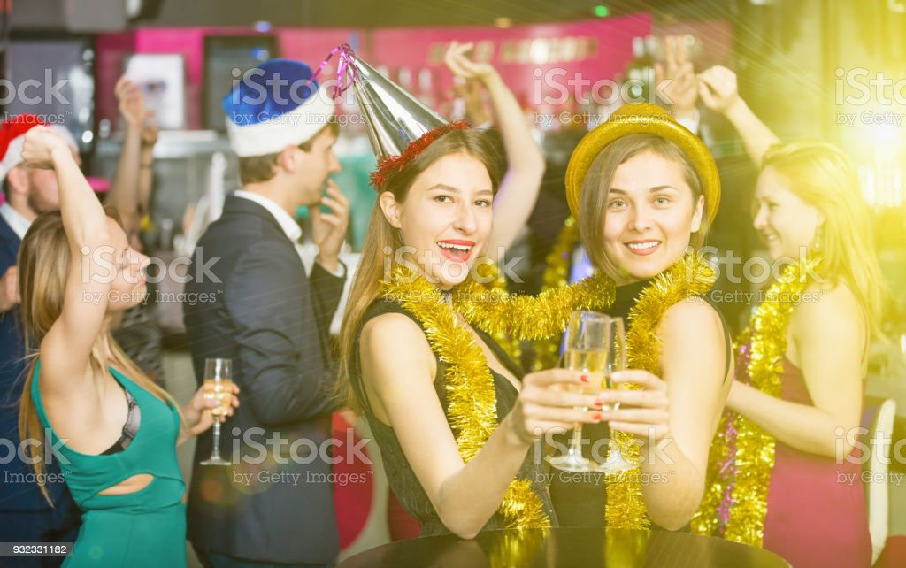 Young friends dancing on new year party stock photo
