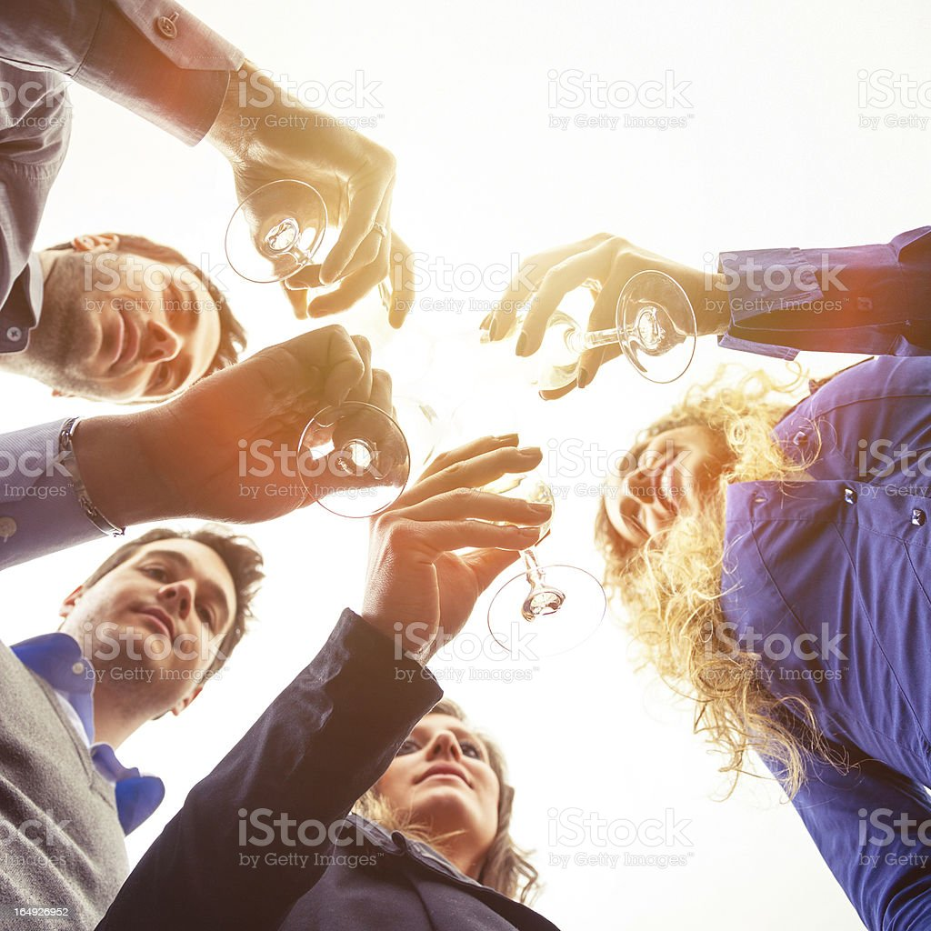 Young friends drinking together stock photo