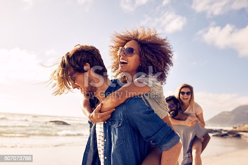 istock Young friends enjoying a day at beach. 507073766