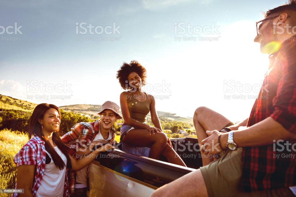 Young friends enjoying the freedom on a Car Trip over a country offroad foto de stock royalty-free