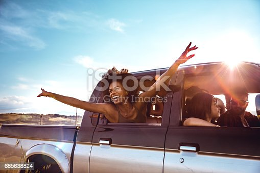 istock Young friends enjoying the freedom on a Car Trip over a country offroad 685638824