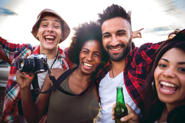 young friends enjoying the freedom on a car trip over a country offroad - concert selfie stock photos and pictures