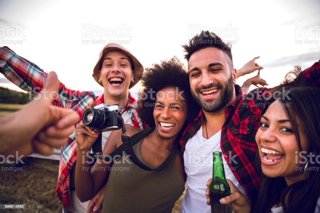Young friends enjoying the freedom on a Car Trip over a country offroad stock photo