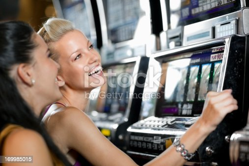 istock young friends  gambling in the casino on slot machines 169985015