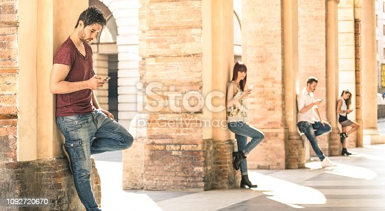 istock Young friends group using smartphone in urban city center - Technology and actual lifestyle with mutual disinterest towards each other - Tech addiction concept with people on modern mobile smart phone 1092720670