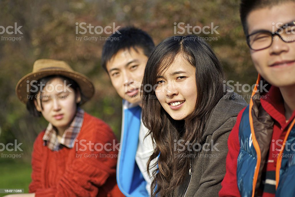 Young friends hanging out together stock photo