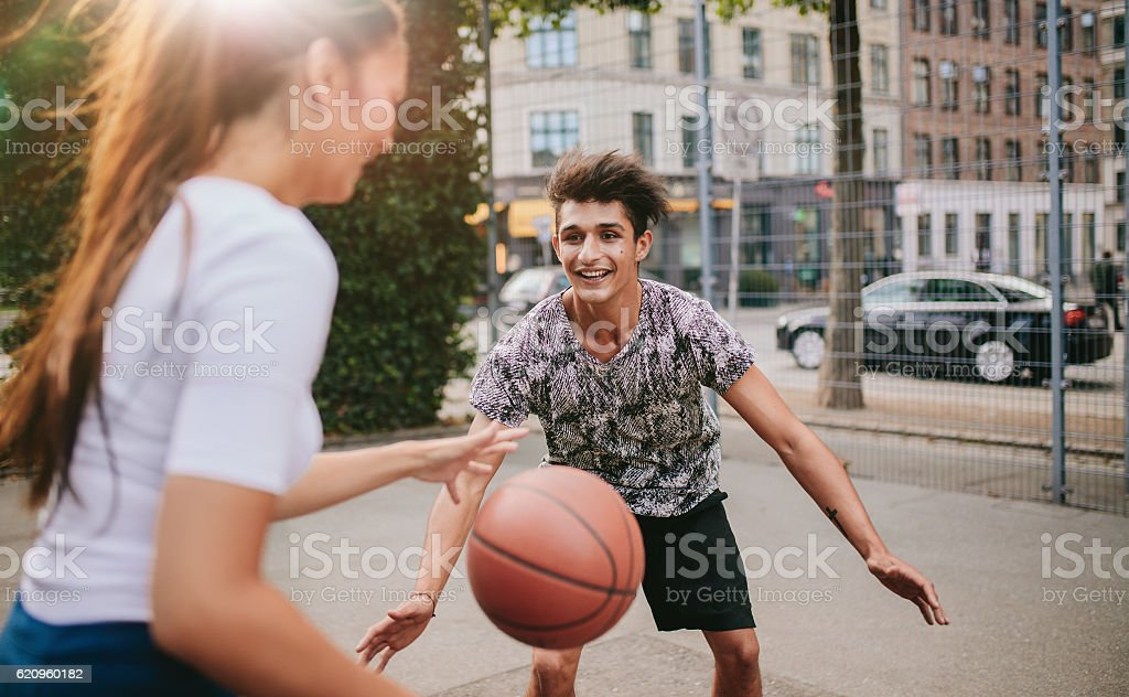 Young friends having a game of basketball stock photo