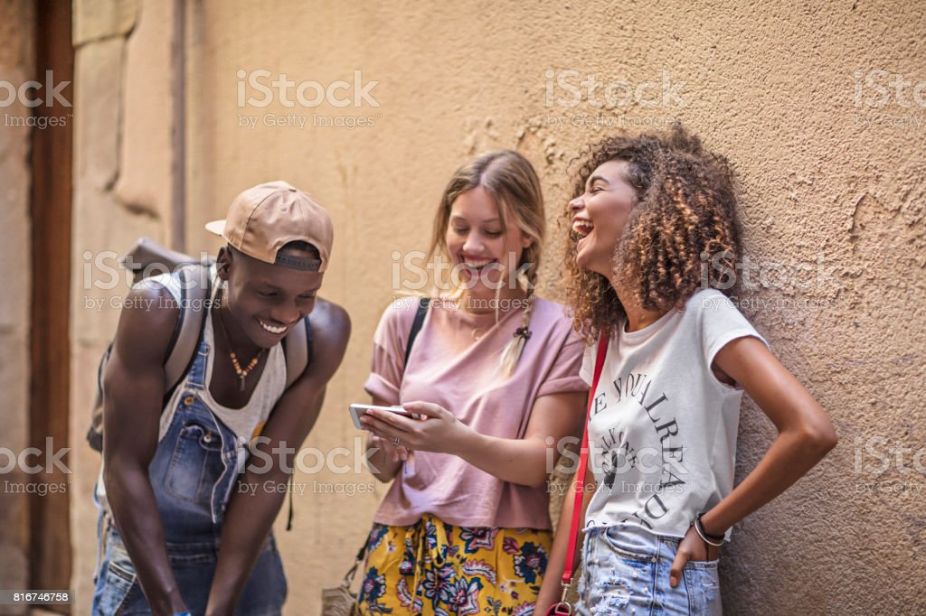Young friends having fun in the city stock photo