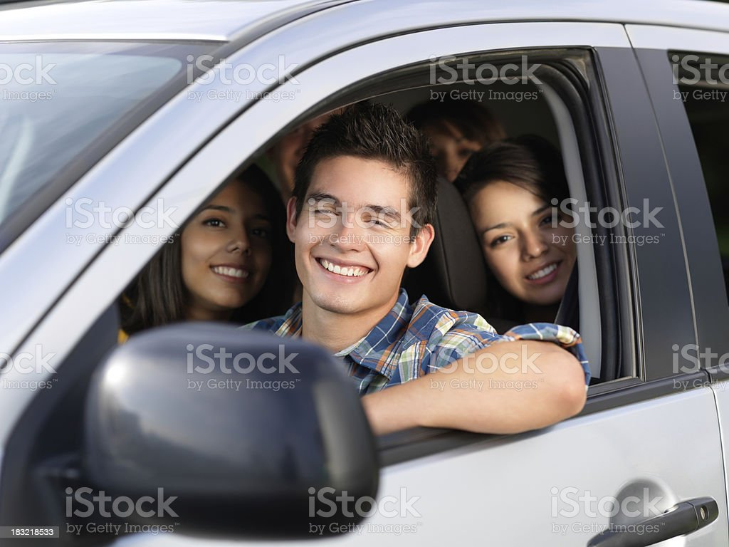Young friends in a car royalty-free stock photo