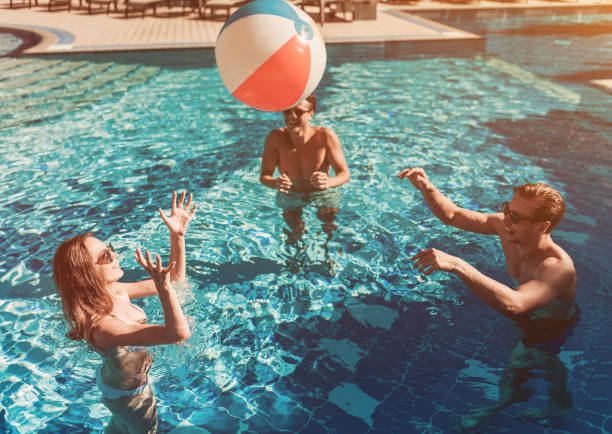 Young friends in swimming pool stock photo