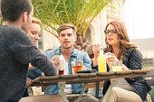 Young friends meeting in beer garden.
