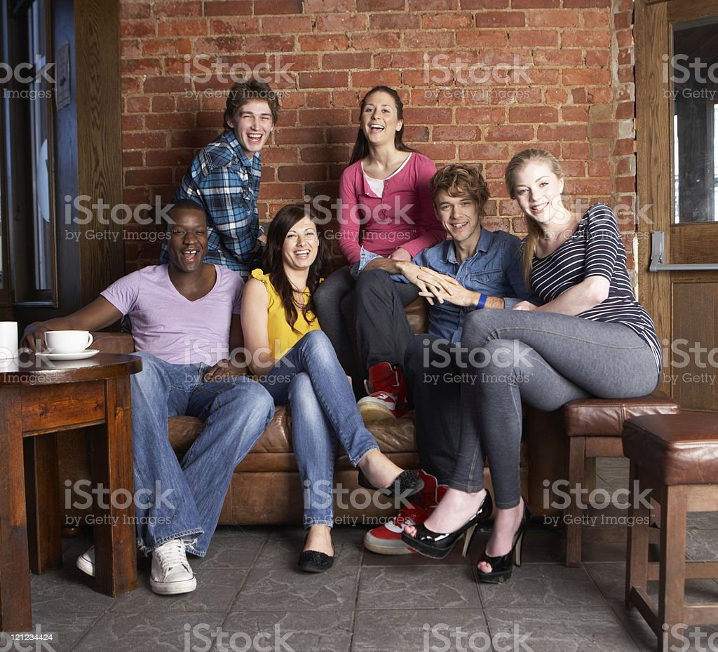 Young friends of different races catching up in cafe royalty-free stock photo