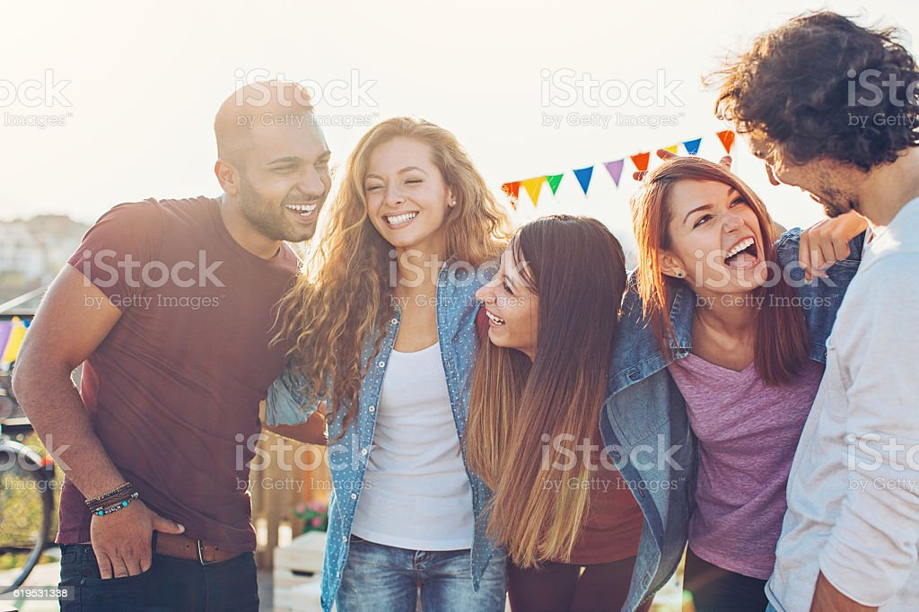 Young friends on a party stock photo