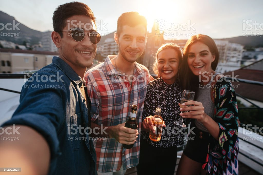 Young friends partying together taking selfie stock photo