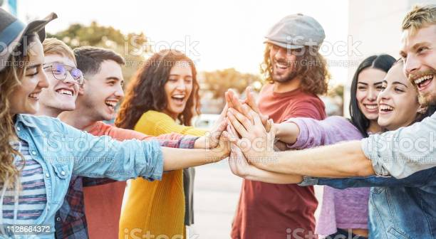 Young friends stacking hands outdoor happy millennial people having picture id1128664372?b=1&k=6&m=1128664372&s=612x612&h=utqdivgmkc9o5q23fuvvvf5hkvz5afb4yfdcjbqdcb0=