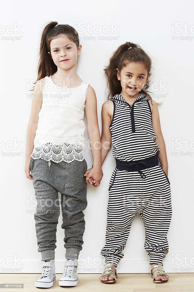 Young friends standing together against white background royalty-free stock photo