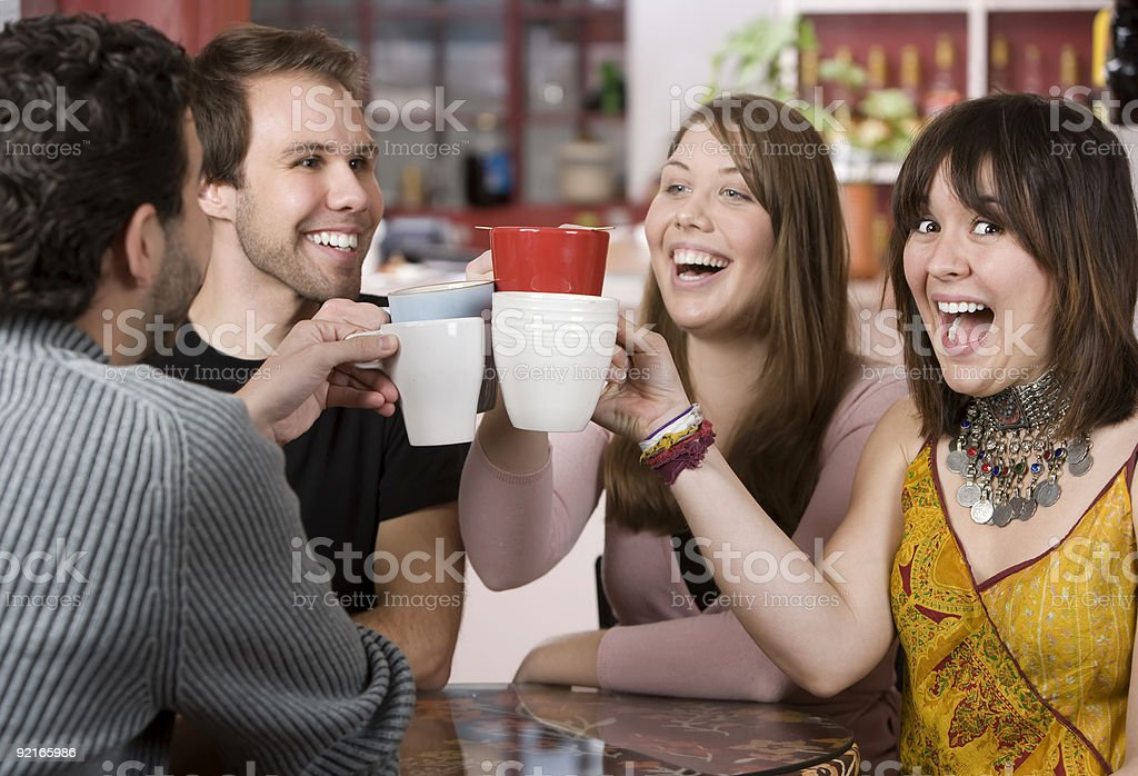 Young Friends Toasting with Coffee Cups royalty-free stock photo