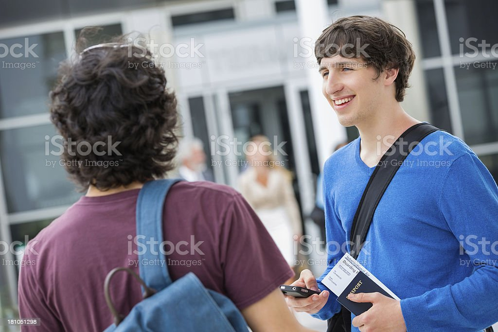 Young friends traveling togeher at airport terminal royalty-free stock photo