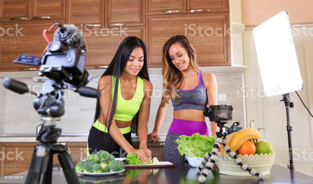 Young friends vlogger recording a healthy eating video for theirs vlog stock photo