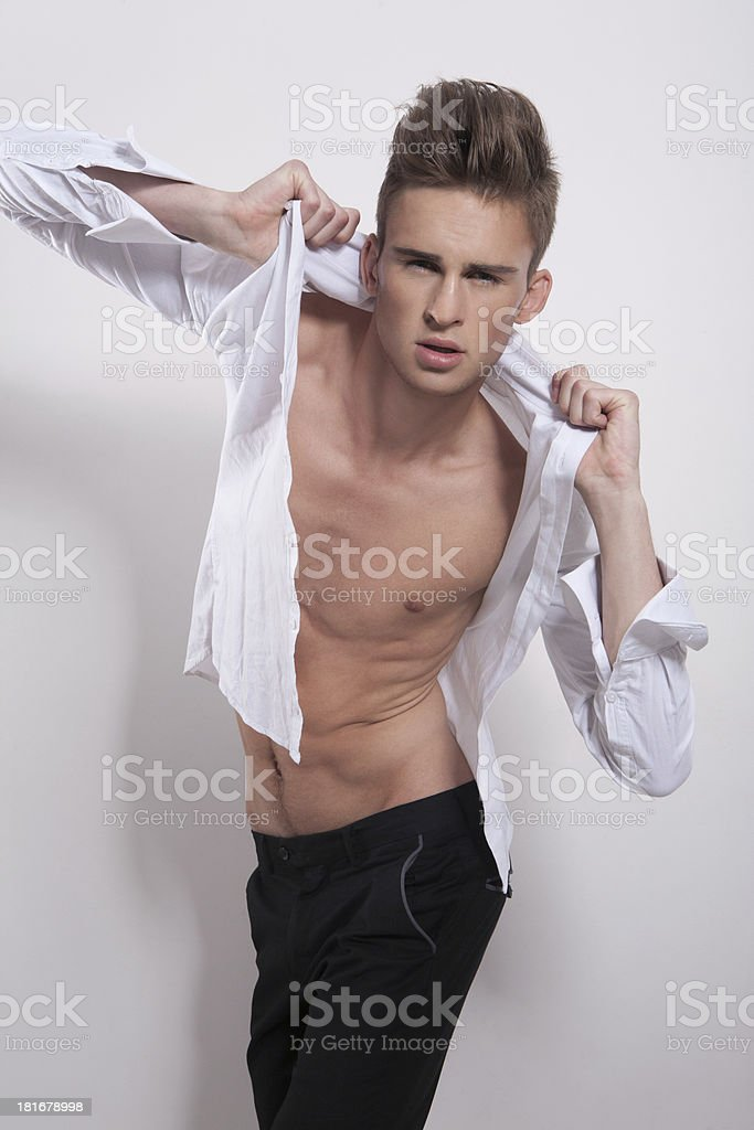 Young frowning male with hands on his shirt royalty-free stock photo