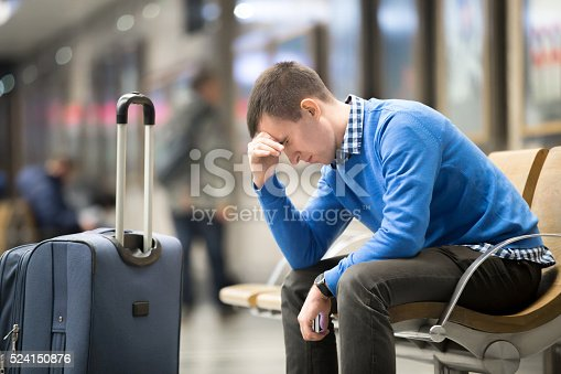 istock Young frustrated man at airport 524150876