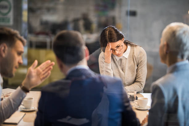 Young frustrated woman failed on a job interview in the office. stock photo