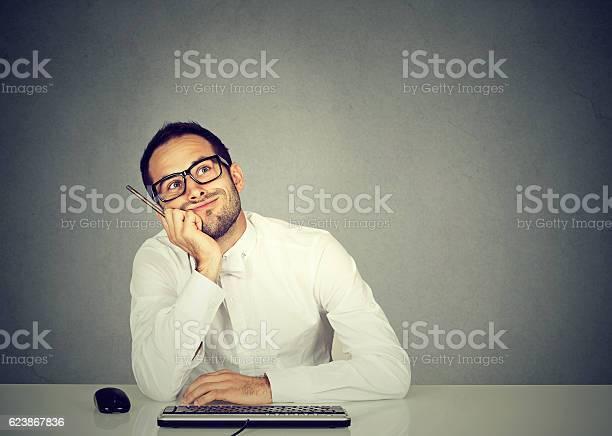 Young funny business man thinking daydreaming picture id623867836?b=1&k=6&m=623867836&s=612x612&h=r04hxk2lu jciezocaghonambun1dnqyn4jzcpqh6am=