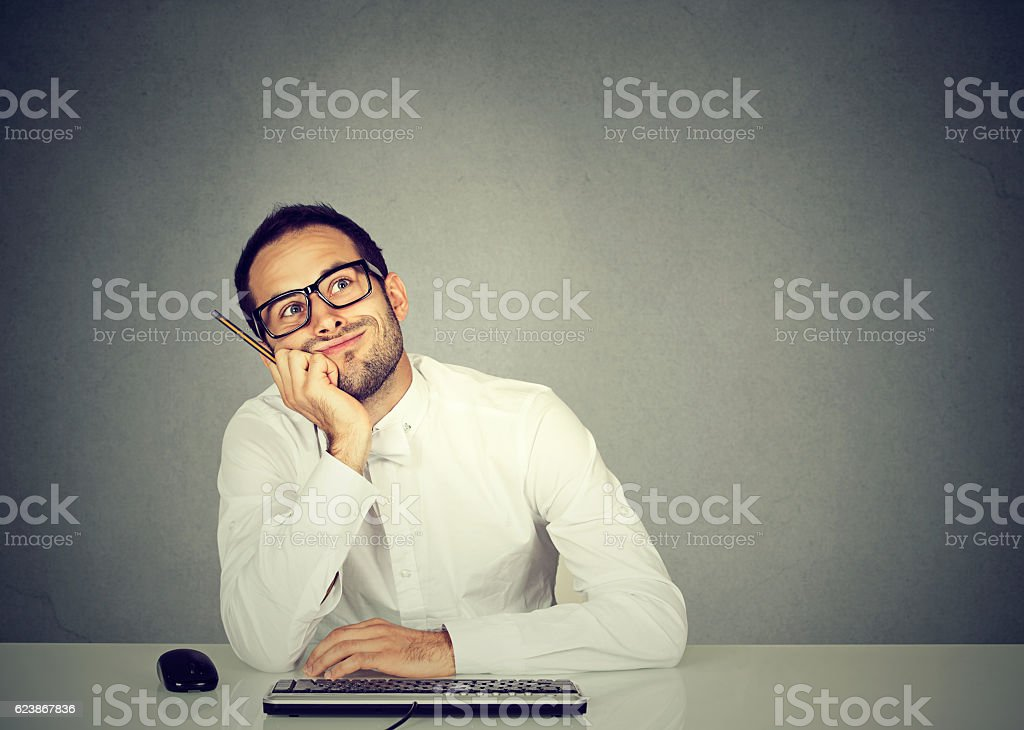 young funny business man thinking daydreaming stock photo