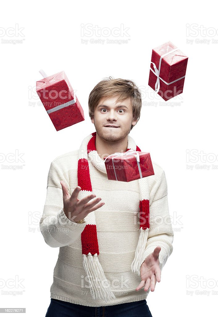 young funny man juggle the christmas gifts royalty-free stock photo