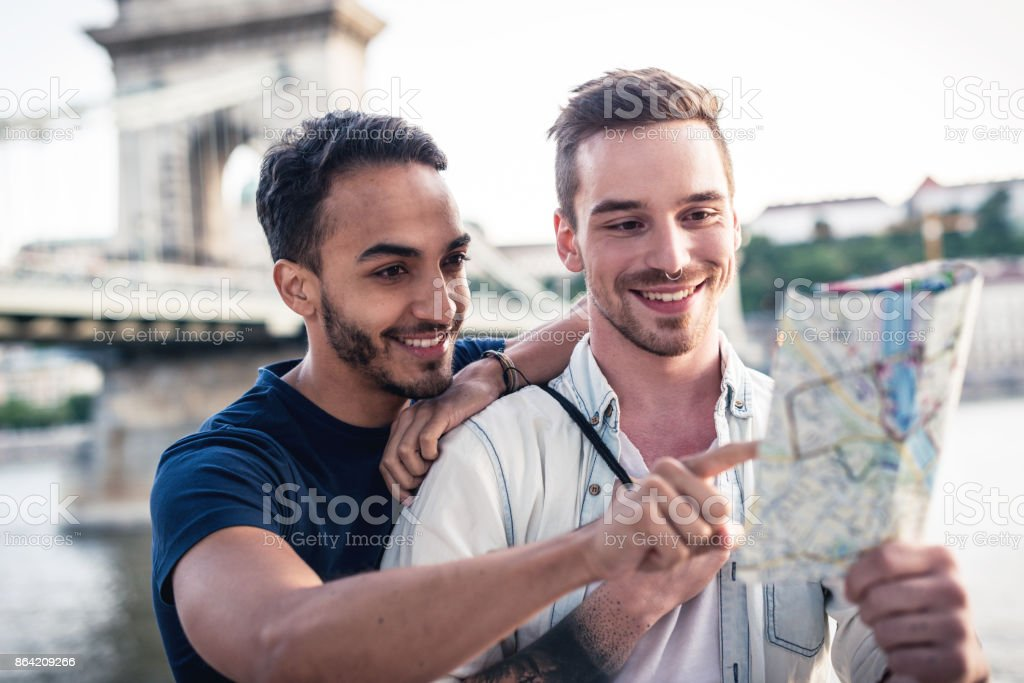 Young gay couple exploring Europe royalty-free stock photo