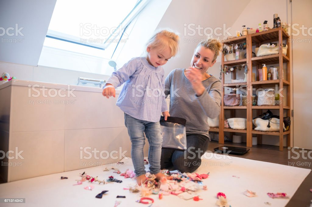 A young German mother playing with her female daughter stock photo