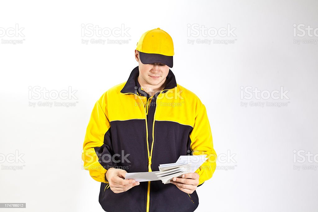 Young german postman delivering letters stock photo