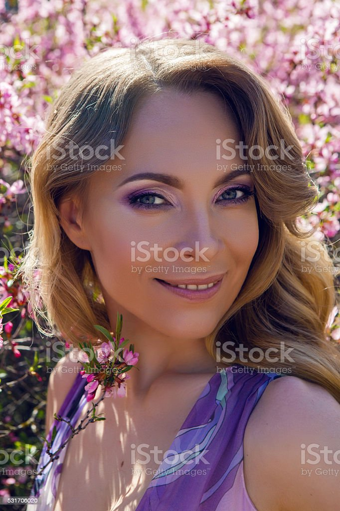 young girl a pink little flowers stock photo