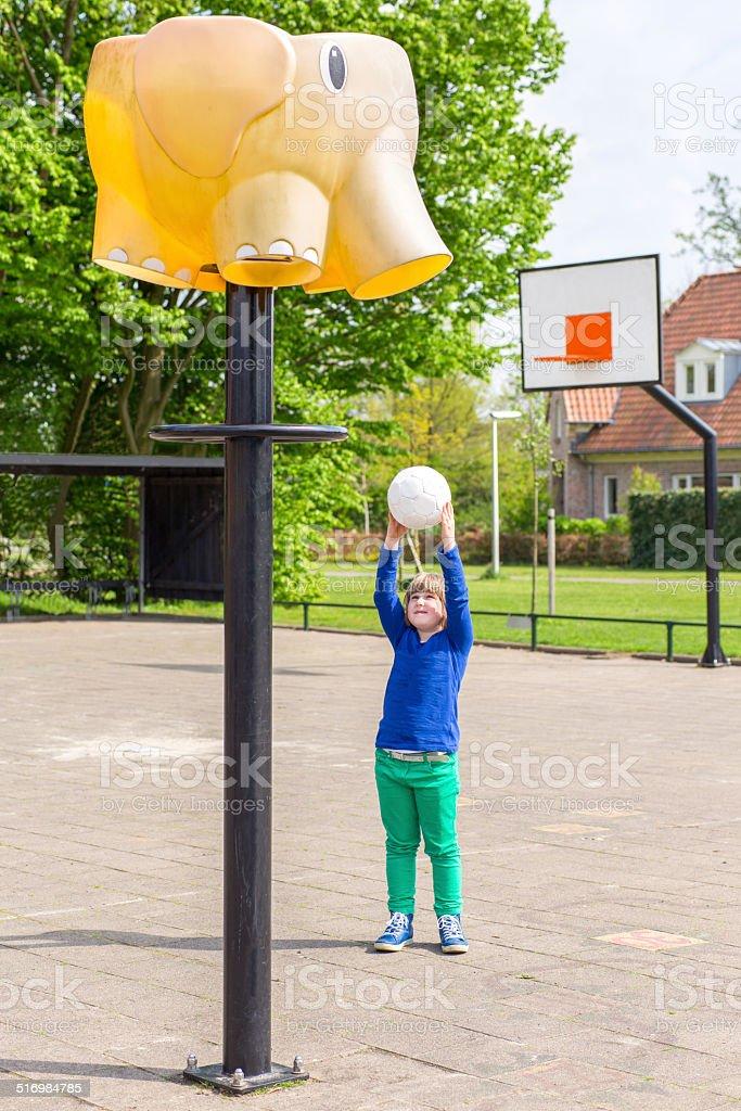 Young girl aiming at basket like elephant stock photo